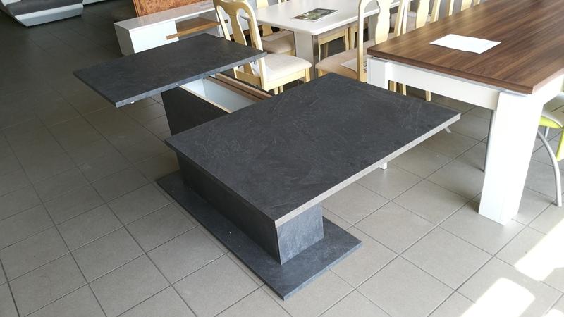 Az asztal középső részében található, a bővíthető elem
